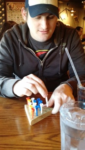 Will he beat the mind puzzle at Cracker Barrel?